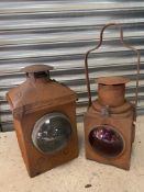 Two railway lamps with bullseye lenses, one stamped 'Brie'.
