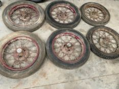 Six assorted Austin 7 wire wheels.