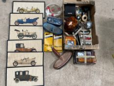 A box of assorted motoring collectables including a set of six car prints, boxed brake hoses, a