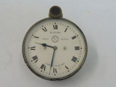 A Jaeger top wind eight day car clock to suit a Vauxhall 30/98 or similar.