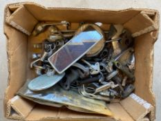 A tray of old car mirrors, bonnet pull, handle etc.