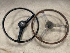 A three spoke steering wheel, possibly Jaguar plus an Austin Cambridge steering wheel.