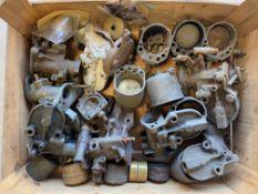 A tray of Austin 7 carburettors.