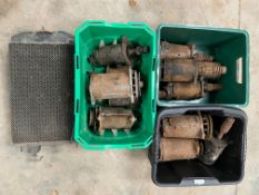 An Austin 7 radiator core with tanks attached plus various starter motors etc.