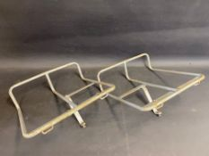 A pair of motorcycle pannier frames.