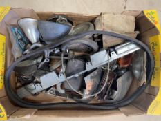 A box of assorted early car parts.