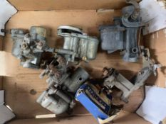 A small box of carburettors.