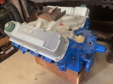 A V8 engine, probably bought to fit a 1960s Chevrolet, fitted with Holley M/T finned aluminium valve