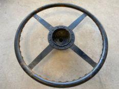 An Alvis four spoke steering wheel.