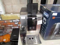 DeLonghi Dinamica Plus bean to cup coffee machine, powers on but not tested all functions. Heavily