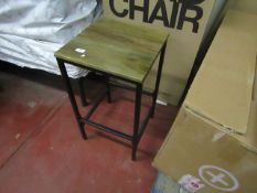 Metal and Wooden stool, the wood seat has a chip on one edge.