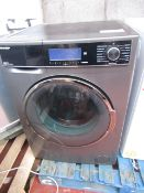 Sharp 10/6kg washer / dryer, powers on but is unresponsive. Heat untested.