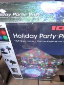 ION holiday party plus indoor/ outdoor projected LED light, Tested working and boxed.
