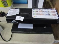 Royal Sovereign counterfeit detector, powers on but not tested all functions.