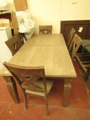 Costco extending dining table and 6 matching chairs, appears to be in good condition just a few