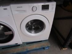 Samsung Eco Bubble 8Kg washing machine, powers on and spins.