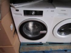 Maytag Zen 8Kg washing machine, powers on and spins.