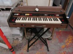 Farfisa Matador80 Vintage Organ sat on a Fold away Keyboard stand, powers on but we haven't