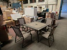Costco stone tile topped outdoor dining table set with 4 chairs, the tile top has a few chips on the