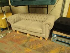 Costco 3 seater button back sofa, no major damage and includes feet.