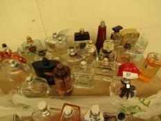 24 Bottles of Tester Perfumes & Aftershaves with Small amounts left in them. Some may be missing the