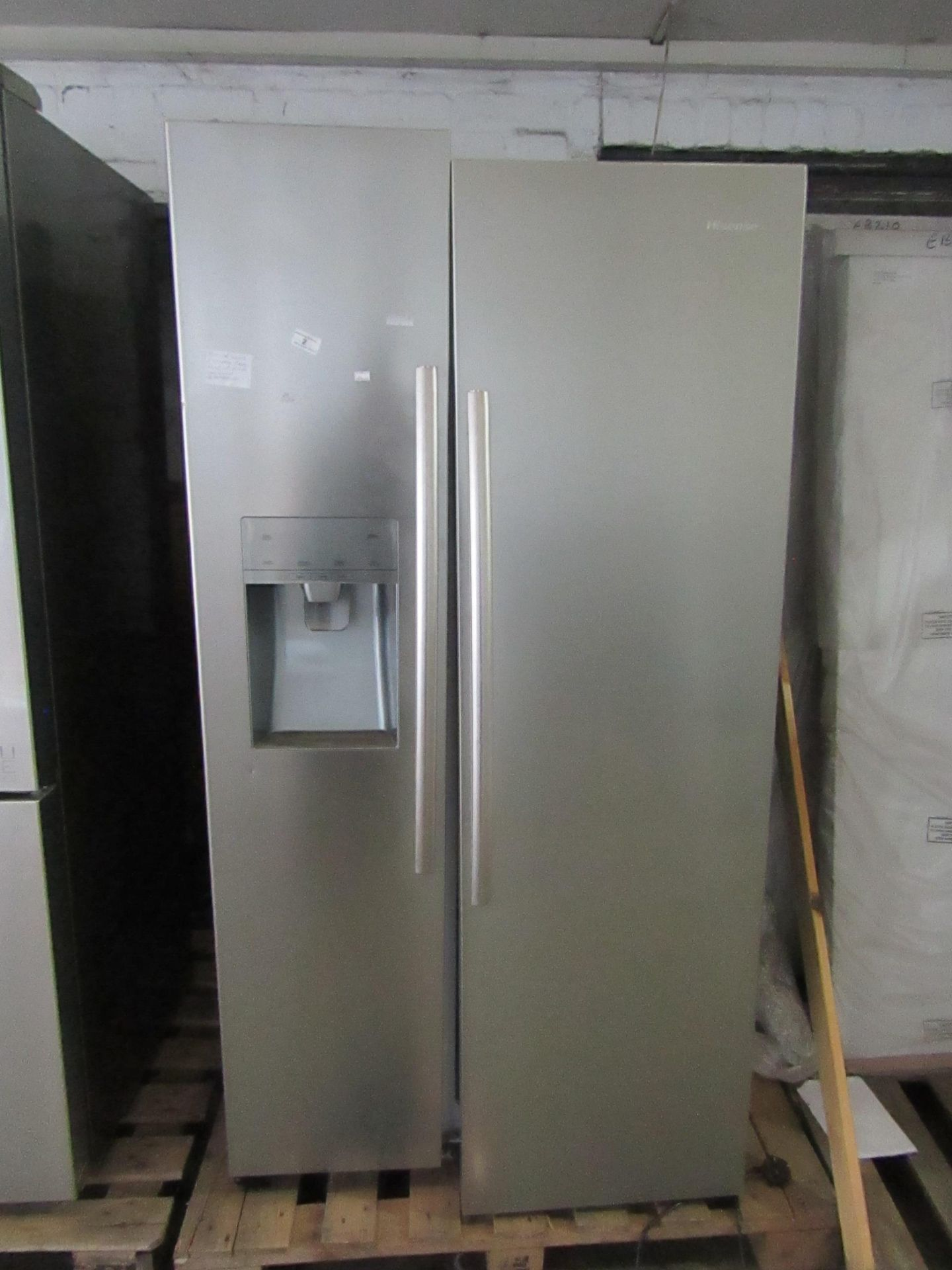 Hisense American Styled stainless steel fridge Freezer - Powers on Unsure if gets cold inside Due to