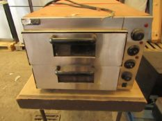 Kukoo Twin counter top pizza oven, requires a new plug and a good clean but we have tested it with a