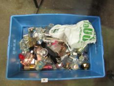Box containing around 30-40 very low/empty bottles of fragrances - see picture