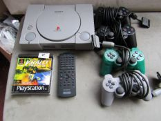 Original Playstation games console with 4 controllers, a remote control and a V-rally game, all