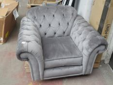 Costco velvet buttoned armchair, no major damage and is missing feet.