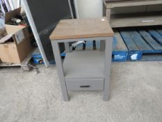 Wooden end table, has bits of damage overall.
