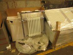 Traditional style 8 section towel radiator, looks unused