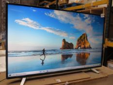 """Toshiba 55"""" 4K HDR TV, tested working but display showing it has a bent near the bottom. Includes"""