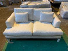 White 2 seater sofa with dark wood plinth
