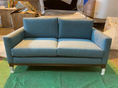 Light blue upholstered 2 seater sofa
