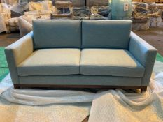 Light blue upholstered two seater sofa