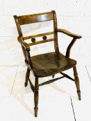 Victorian elm seat elbow chair.