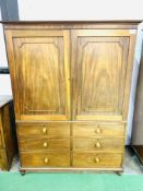Victorian mahogany linen press over chest of 3 graduated drawers.