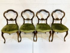 Set of four Victorian mahogany balloon back dining chairs.