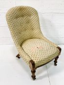Victorian lady's drawing room chair with button back upholstery.