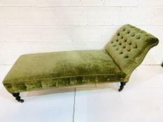 Green velvet button back upholstered chaise lounge.