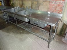 Stainless steel double sink, right hand drainer with taps, drawer and undershelf.