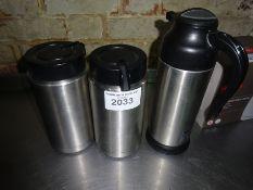 Three insulated flasks.
