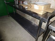 Stainless steel preparation table with under shelf, together with a can opener.