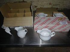 Twelve Villeroy & Boch china milk jugs.