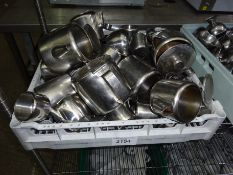 Stainless steel teapots and milk jugs.