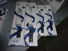 Four Le Cordon Bleu knives, small and large santoku, bread and utility.