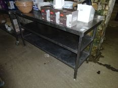 Stainless steel preparation table with two under shelfs.