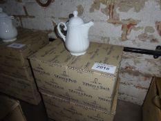 Eight Villeroy & Boch china teapots.