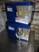 Twelve wine glasses.
